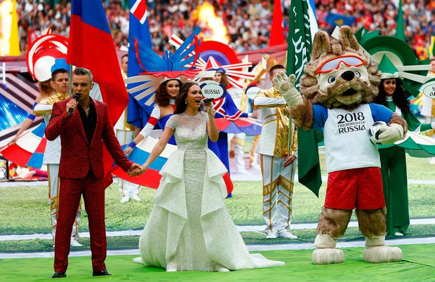 Robbie Williams and Aida Garifullina perform ahead of the match between Russia and Saudi Arabia which opened the 2018 soccer World Cup at the Luzhniki stadium in Moscow, Russia. Image: AP Photo/Matthias Schrader