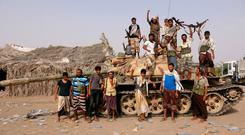 Tribal fighters loyal to the Yemeni government stand by a tank in al-Faza area near Hodeida, Yemen June 1, 2018. Picture taken June 1, 2018. REUTERS/Stringer
