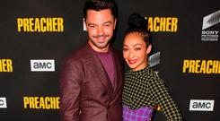 Dominic Cooper (L) and Ruth Negga attend the premiere of AMC's