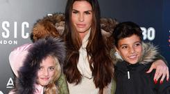 Katie Price attends the 'Shocktober' press night with her children Princess (L) and Junior (R) at Tulleys Farm on October 6, 2017 in Crawley, West Sussex. (Photo by Tabatha Fireman/Getty Images)