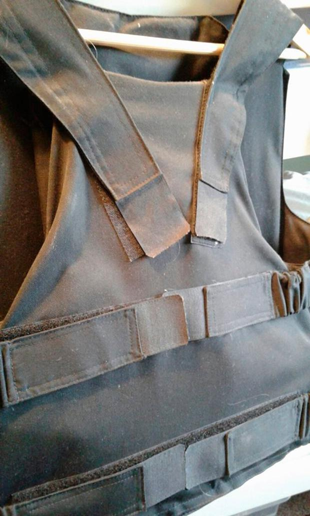 Photos posted on the official Garda Síochána Facebook page show a bundle of cash and what appears to be a bullet-proof vest