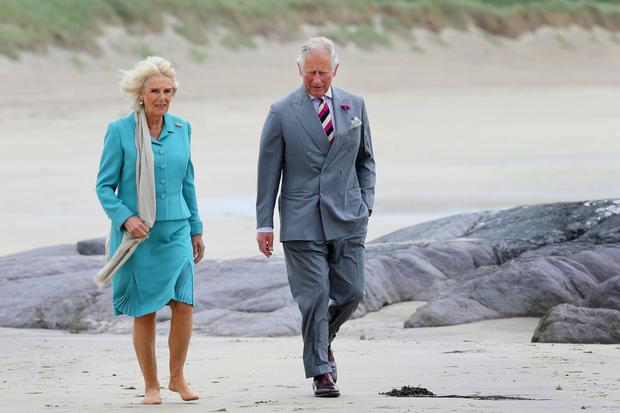 Britain's Prince Charles and Camilla, Duchess of Cornwall pictured as the took a stroll along Derrynane beach during their visit to Derrynane House in Caherdaniel Co Kerry. Picture Credit:Frank McGrath