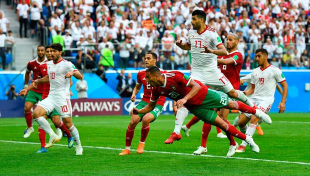 Morocco's Aziz Bouhaddouz scores an own goal for Iran's first goal