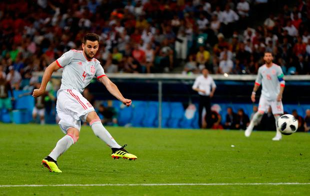 Spain's Nacho scores his side's third goal during the group B match between Portugal and Spain at the 2018 soccer World Cup in the Fisht Stadium in Sochi, Russia.
