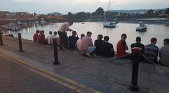 Waterford footballers relax by the dockside in Dungarvan last Saturday night following their victory over Wexford