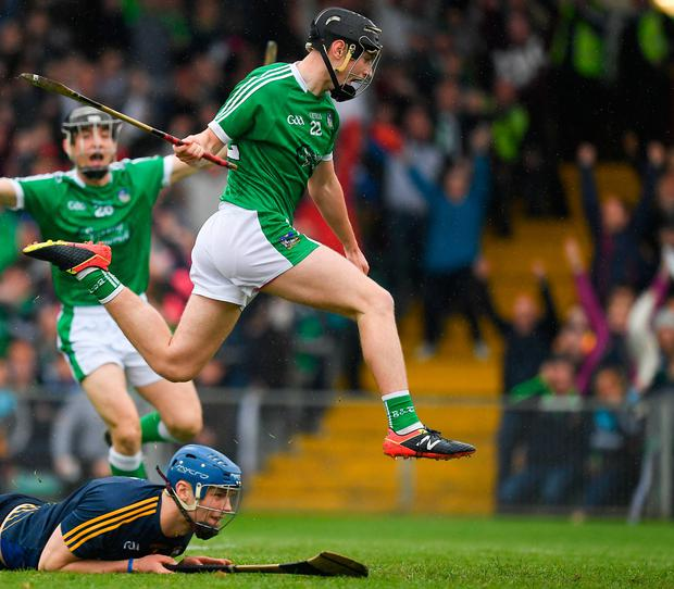 Barry Murphy jumps over Tipp goalkeeper Brian Hogan as he celebrates scoring a crucial, late goal for Limerick in their Munster SHC opener last month. Photo: Sportsfile