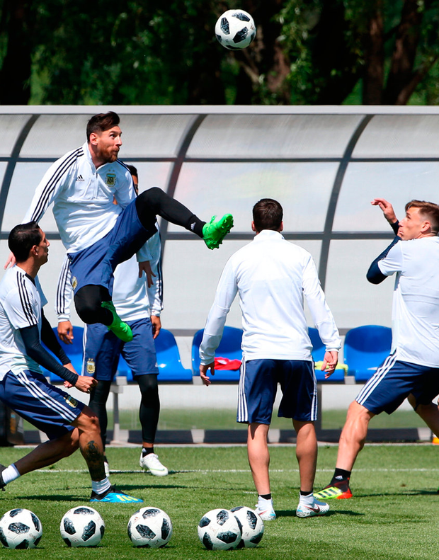 Argentina star Lionel Messi jumps for the ball during training ahead of their game against Iceland Photo: Getty