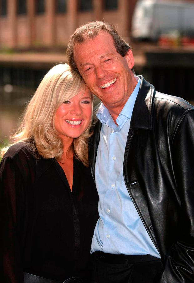 Leslie Grantham with actress Letitia Dean Photo: Myung Jung Kim/PA Wire