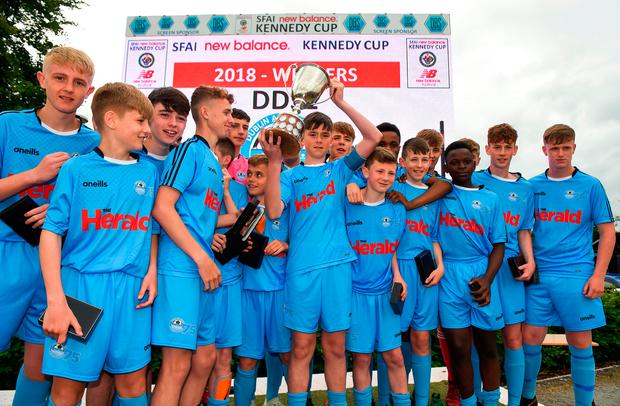 CHAMPIONS: The DDSL celebrate with the Kennedy Cup Pic:Sportsfile