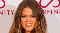 Khloe Kardashian has paid a glowing tribute to her brother, Rob. (Dominic Lipinski/PA)