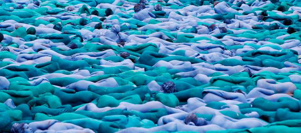 Nude models pose for a photograph by U.S. artist Spencer Tunick, for a project titled