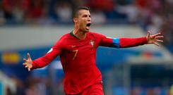 Soccer Football - World Cup - Group B - Portugal vs Spain - Fisht Stadium, Sochi, Russia - June 15, 2018 Portugal's Cristiano Ronaldo celebrates scoring their third goal REUTERS/Hannah McKay