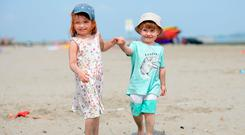 Kate Kent, 4, and her brother Jack, 2, from Artane, enjoying the good weather earlier this month. Dollymount beach, Bull Island, Dublin. Picture: Caroline Quinn