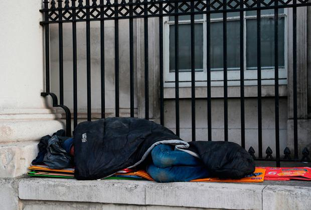 A rough sleeper outside Dublin's Custom House. Photo: Brian Lawless