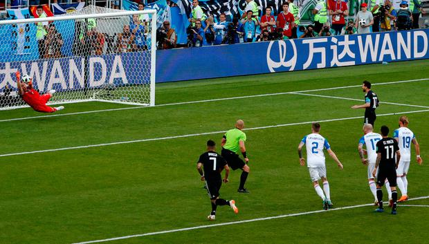 Iceland goalkeeper Hannes Halldorsson saves a penalty attempt by Argentina's Lionel Messi during the group D match between Argentina and Iceland at the 2018 soccer World Cup in the Spartak Stadium in Moscow, Russia, Saturday, June 16, 2018. (AP Photo/Rebecca Blackwell)