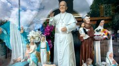 A statue of Pope Francis in a shop window in Knock, Co Mayo. Photo: Tony Gavin