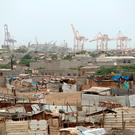 Hodeidah port's cranes are pictured from a nearby shantytown. Photo: Reuters