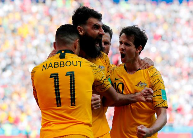 Australia's Mile Jedinak celebrates scoring their goal with team mates. Photo: Toru Hanai/Reuters