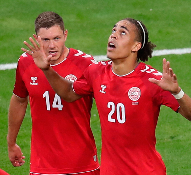 997b7331d18 Denmark's Yussuf Poulsen celebrates scoring his side's winning goal against  Peru with Henrik Dalsgaard. Photo