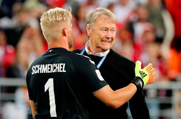 Denmark's Kasper Schmeichel celebrates with coach Age Hareide after the match. Photo: Marcos Brindicci/Reuters