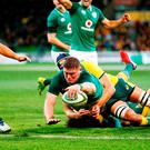 Tadhg Furlong stretches out to score his first international try, against Australia in Melbourne. Photo: Daniel Pockett/Getty Images