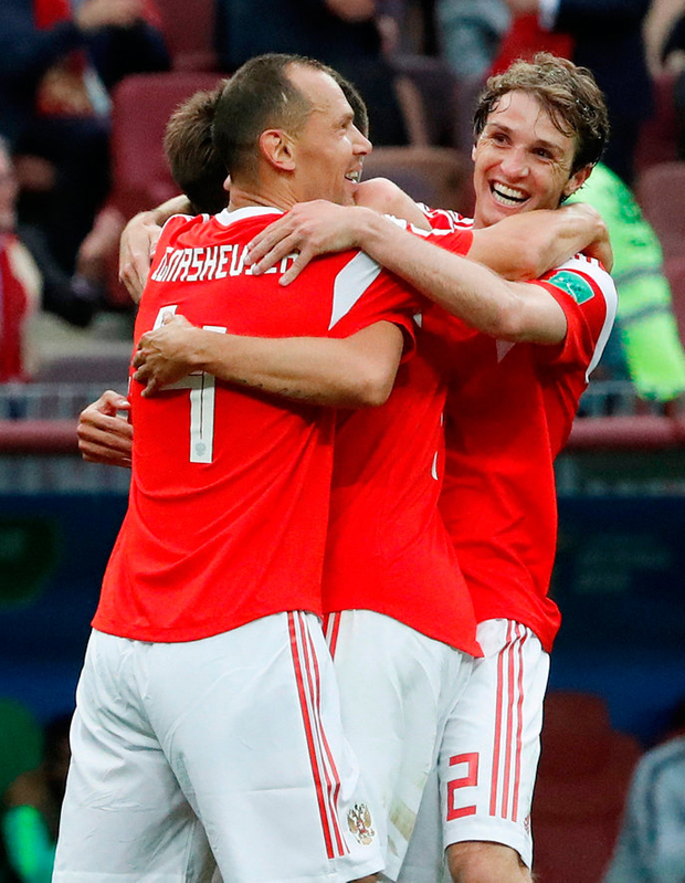 Russia's Aleksandr Golovin celebrates scoring his side's fifth goal with team mates. Photo: Grigory Dukor/Reuters