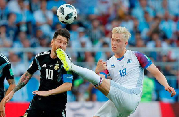 Argentina's Lionel Messi battles with Iceland's Hordur Bjorgvin Magnusson. Photo: Maxim Shemetov/Reuters