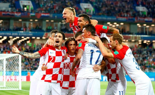 Croatia's Luka Modric celebrates with team mates after scoring his side's second goal. Photo: Reuters