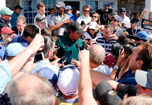 Phil Mickelson speaks to media after playing the third round of the U.S. Open golf tournament at Shinnecock Hills GC - Shinnecock Hills Golf C. Mandatory Credit: Dennis Schneidler-USA TODAY Sports