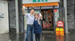 Store owner John Brady celebrates the €2m Lotto jackpot with Mandy Gazely at the Mace Burrows Store in Kilmore Quay, Co. Wexford.