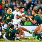 South Africa's Tendai Mtawarira, left, and Handre Pollard tackle England's Billy Vunipola during the second rugby test match between South Africa and England in Bloemfontein