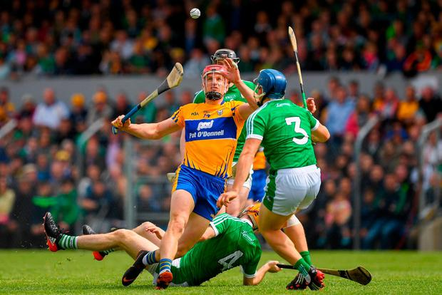 John Conlon of Clare in action against Mike Casey of Limerick, 3, during the Munster GAA Hurling Senior Championship Round 5 match between Clare and Limerick at Cusack Park in Ennis, Clare. Photo by Ray McManus/Sportsfile