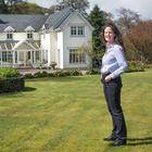 Jean outside her home, which is on three acres of wonderful grounds boasting a natural waterfall and stream. The house was extended in 2010 to include the sun room. Photo: Tony Gavin