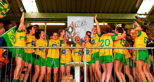 Donegal players celebrate with the cup after their Ulster Final win over Armagh. Photo: Daire Brennan/Sportsfile