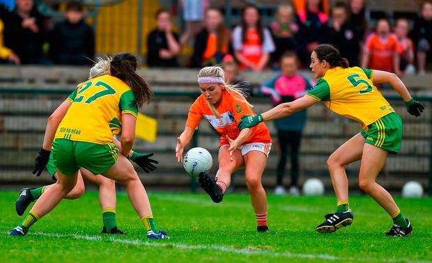 Armagh's Lauren McConville is quickly swarmed by Emer Gallagher, left, and Therese McCaffrey. Photo: Daire Brennan/Sportsfile