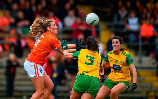 Kelly Mallon claims the ball ahead of Donegal's Nicole McLaughlin. Photo: Daire Brennan/Sportsfile