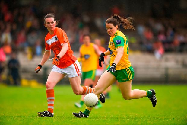 Sarah Marley pictured in close pursuit of Donegal's Bridget Gallagher. Photo: Daire Brennan/Sportsfile