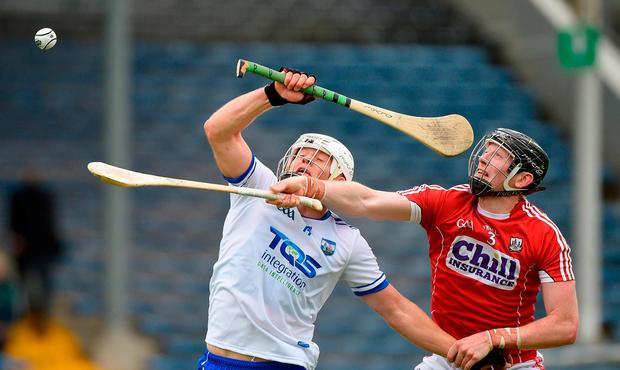 Cork's Damien Cahalane stretches to win the ball ahead of Waterford's Tommy Ryan at Semple Stadium yesterday. Photo: Matt Browne/Sportsfile