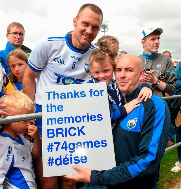 Michael 'Brick' Walsh has his photograph taken with Beth Ryan, age 5, and her father Derek. Photo: Matt Browne/Sportsfile