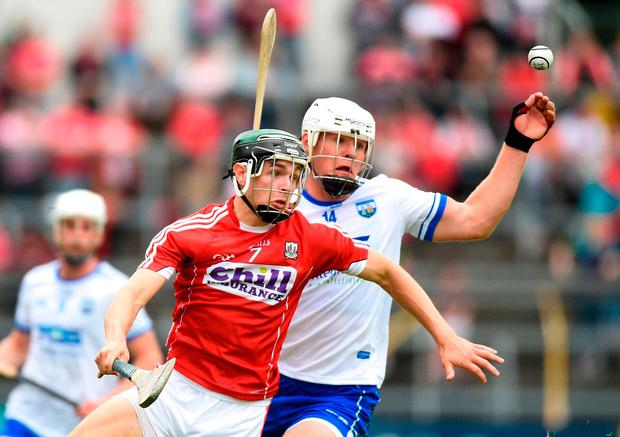 Mark Coleman and Tom Devine of Waterford battle for possession. Photo: Matt Browne/Sportsfile