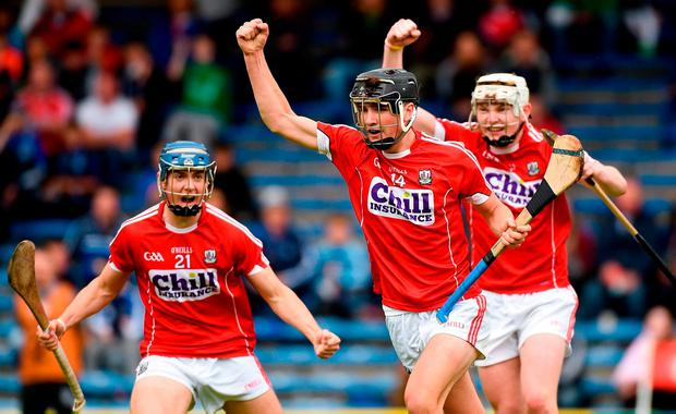 Padraig Power celebrates with teammates after scoring Cork's second goal. Photo: SPORTSFILE