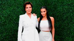 TV personalities Kris Jenner and her daughter Kim Kardashian West attend the 2018 MTV Movie and TV Awards in Santa Monica, California. Photo: Emma McIntyre/Getty Images for MTV