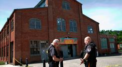 Police stand guard outside the warehouse building where the festival took place in Trenton, New Jersey. Photo: AP Photo/Mel Evans