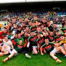 Mayo players celebrate with the cup after their EirGrid Connacht GAA Football U20 Championship final victory over Roscommon. Photo: Piaras Ó Mídheach/Sportsfile