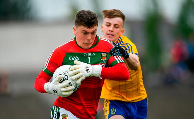 Mayo goalkeeper Patrick O'Malley keeps control of the ball. Photo: Ramsey Cardy/Sportsfile