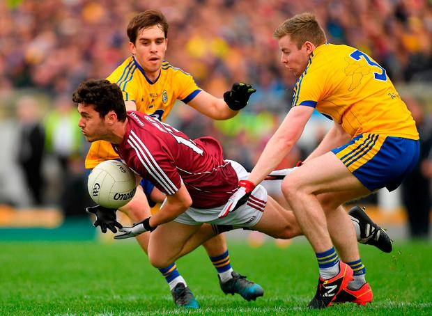 Galway's Ian Burke gains possession ahead of David Murray, left, and Peter Domican. Photo: Piaras Ó Mídheach/Sportsfile