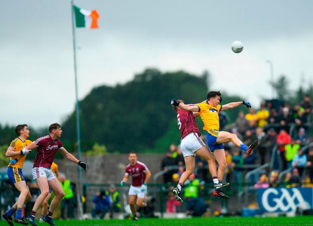 Paul Conroy and Tadhg O'Rourke battle in the air. Photo: Ramsey Cardy/Sportsfile