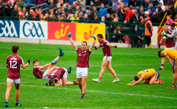 Cathal Sweeney puts his fists in the air as Galway celebrate at the final whistle. Photo: Ramsey Cardy/Sportsfile