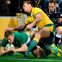 Ireland's Andrew Conway, left, scores a try during their International with Australia in Melbourne. (AP Photo/Andy Brownbill)