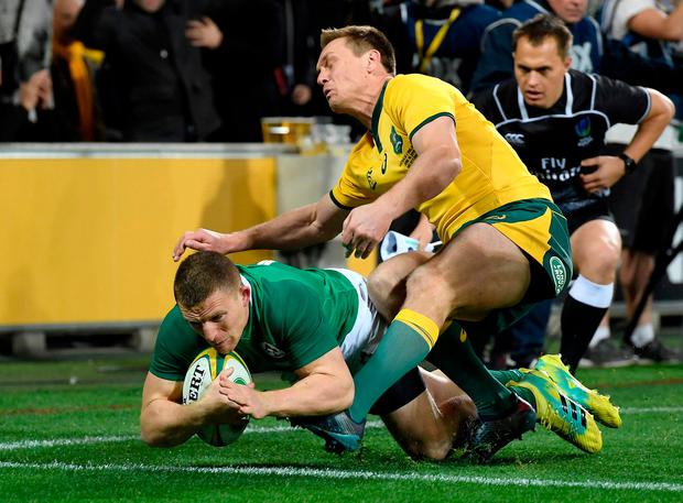 Ireland's Andrew Conway, left, scores a try during the international rugby match between Australia and Ireland in Melbourne, Australia, Saturday, June 16, 2018. (AP Photo/Andy Brownbill)